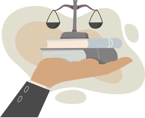 Eine Hand hält Bücher und eine Waage die Justitia Figur symobilisiert